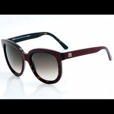 Balenciaga Havana Sunglasses Made in Italy. Burgundy Balenciaga shades with tortoise shell inlay. Super glamorous and flattering shades with just some scratching on the temple and lower corner of frame, but unnoticeable when worn. Comes with original case and dust bag. Balenciaga Accessories Sunglasses