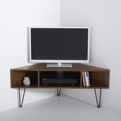 The vintage look is back, and this wood and metal corner TV unit offers plenty of storage space with a statement look. Description of Watford vintage corner TV compartments large compartment for DVD player and 2 sm Corner Tv Stands, Corner Tv Unit, Corner Tv Stand Ideas, Corner Tv Table, Corner Tv Shelves, Corner Tv Cabinets, Tv Furniture, Living Room Furniture, Furniture Ideas
