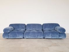 For Sale on - Mario Bellini designed this amazing modular sectional sofa for C&B Italia. These elements have been reupholstered in blue velvet. We have more original