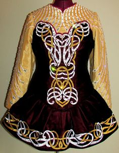 Warm colored Kirations dress with subtle swans in the design on the breast.