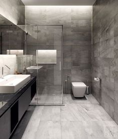 Bathroom: floor to roof charcoal tiles with a black ...