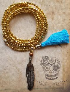 Gold Lariat Mala with feather charm & turquoise tassel.
