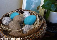 Someday Crafts  plastic eggs covered wtih twine or strips of paper