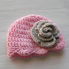 Beautiful handmade baby flower hat for your princess! This crochet baby girl hat is the perfect baby gift or photo prop, but is also made for everyday style and warmth. { HANDMADE } Made to order and crocheted by me. Please check my shop announcement for current turnaround times: prairieheartstrings.etsy.com   { MATERIALS } Handmade from acrylic yarns.   { SIZES } 0 to 3 months ( 14-15 circumference ) 3 to 6 months ( 15-16 circumference ) 6 to 12 months ( 17 - 19 circumference )   { CARE…