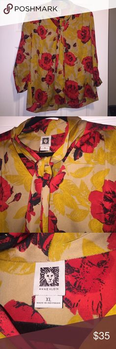 Anne Klein Blouse with Neck Tie Such a beautiful Blouse with burnt orange undertones and beautiful red roses and an adorable neck tie that you could put a knot or a bow in. There are no stains or tears. Anne Klein Tops Blouses