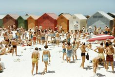 South Africans relax on a sunny, cabana-lined beach in Cape Town, South Africa, August 1953, National Geographic