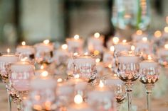 Votives with floating candles…. www.stemfloral.com  |  www.studio563.com
