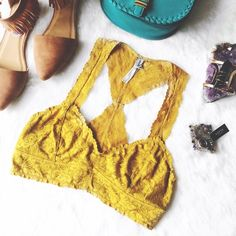 Free People Golden Yellow Lace Bralette Free People lace bralette, size M, in good used condition. Selling because I don't wear them anymore. Please ask if you have any questions. Bundle and Save Free People Intimates & Sleepwear Bandeaus