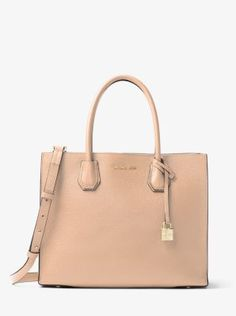 Crafted from bonded leather for an exceptionally lightweight feel, our streamlined Mercer tote, a part of our Kors Studio Collection, is a thoughtful update to a timeless silhouette. Tuck important items—such as your keys, tablet and wallet—in the median zippered compartment, and carry it by its elegant top handles or as a hands-free crossbody.