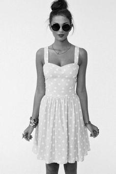 The bracelets & ring neutralize the girly dress.