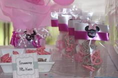 minnie mouse theme, Minnie mouse theme, pink and white party, wafer sticks, chocolate covered pretzels, balloon, candy bar, sweet table, edible party favo