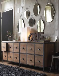 Gray wall with mirrors, clean-lined furniture