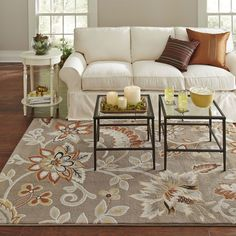 """Warm up any room with the orange and yellow accents of this 5'2"""" x 7'2"""" Tufted Cotton Area Rug Neutral Beige Yellow Orange Floral Pattern. Flowing florals are set against a neutral backdrop to create"""
