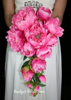 peony bouquet... This shape but cream peonies.. White orchids.. And peacock feathers.. I think so!