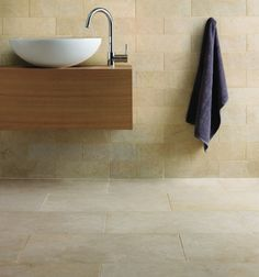 Java Limestone in a velvet finish. A hardwearing limestone tile, made up of pale yellows, greens and greys.