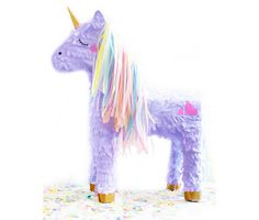 This majestic baby unicorn piñata has magical artwork that feature rosy cheeks with a pastel mane and tail, a gold glittered horn and matching hooves. Use as a piñata or as unique decor.  PARTY KIT INCLUDES: 1 cup of confetti, 10 solid balloons & 3 pre-stuffed confetti balloons, all made to match the unicorns mane.   ADDITIONAL INFO: • Piñata measures 21L x 10W x 26H. • Each balloon measures 11 in diameter.  PLEASE READ FAQS BELOW FOR MORE INFO ON THIS PIÑATA↓↓↓.