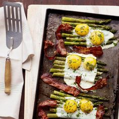 Sweet, fresh asparagus perks up this go-to brunch combo. If you're worried about breaking the egg yolks, crack each egg, one at a time, into a small cup or bowl before pouring onto the asparagus.Recipe: Bacon and Eggs Over Asparagus Breakfast And Brunch, Brunch Menu, Breakfast Recipes, Sunday Brunch, Brunch Ideas, Bacon Breakfast, Brunch Food, Sunday Morning, Camping Breakfast