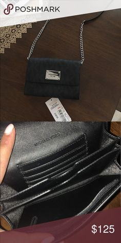 Mk crossbody NWT small scratch on the silver not noticeable at all must have this size fits iPhone 6-7.. fits my plus no  case Michael Kors Bags Crossbody Bags