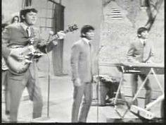 We Gotta Get Out Of This Place-The Animals-(Live)-1965 - From A 1965 T.V. Show.The Vocals Are Live.This Is Not A Lip-Synch.The Backing It Sounds Pre-Recorded.But If They're Singing Live It Counts As Live.Many Acts Even Today Sing Over Pre-Recorded Backing Tracks.Mainly Because It's Hard To Get The Sound You Want.Eric Rocks He Sounds Great Live.