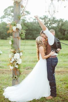 Adorable first kiss as husband and wife // J Photography