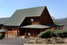Pigeon Forge Two Bedroom Cabin that has a pool table, air hockey table,arcade gaming system,fooseball table,indoor swimming pool access,outdoor swimming pool access, and access to a minature golf course