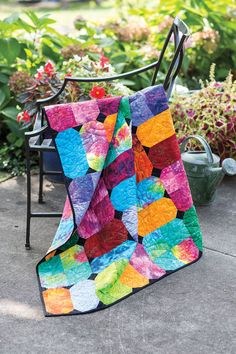 Here's to looking on the bright side! Rochelle Martin cut bold batiks and prints into large squares and rectangles for this fast and easy design.