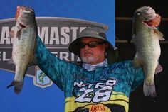 Rick Clunn with two bass, from his limit that weighed 32+lbs, on the 2nd day of the Bassmaster Falcon Lake Slam.