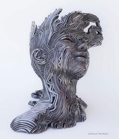 Flow: Stainless Steel Ribbon Sculptures by Gil Bruvel