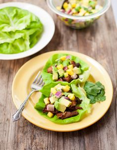 Crisp and tender slow-cooker carnitas are wrapped in butter lettuce and topped with pineapple and avocado salsa for a paleo dinner or appetizer with an ideal balance of sweet and savory flavors.