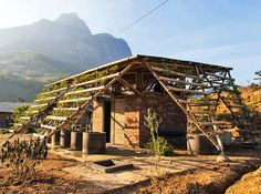 H&P Architects designed this bamboo restroom covered in foliage for a school in rural Vietnam.