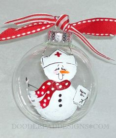Hand painted Nurse Christmas Ornament by doodlepaddesigns on Etsy