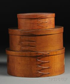 Three Shaker Red-stained Oval Covered Storage Boxes | Sale Number 2618B, Lot Number 441 | Skinner Auctioneers