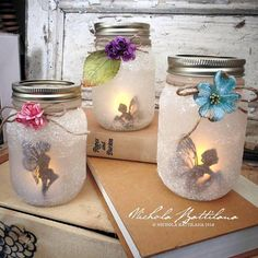 Fairy Jar Lanterns glass jars craft ideas These Gorgeous Fairy Jar Lanterns Are Magical Pot Mason Diy, Mason Jar Crafts, Bottle Crafts, Fairy Lanterns, Glass Lanterns, Mason Jar Lanterns, Solar Mason Jars, Fairy Silhouette, Fairy Crafts