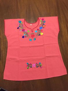 Blusa bordada Tela Manta Disponible en tienda