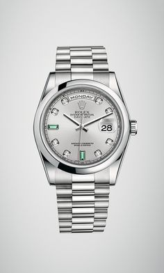A Rolex Day-Date 36 in 950 platinum with a domed bezel, rhodium dial set  with diamonds and emeralds and President bracelet. R C Wahl Jewelers 8fc74dd266