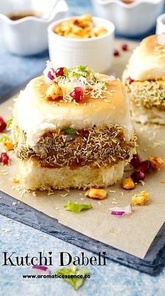 Dabeli is a popular street food that originated in Kutch, Gujarat in India. Hence it is also known as kutchi or kachchi dabeli! It is a common and popular street food in Mumbai too. It is easy to spot tiny carts selling this yummy snack, doting the cities Yummy Snacks, Snack Recipes, Yummy Food, Bread Recipes, Gujarati Recipes, Indian Food Recipes, Ethnic Recipes, Chaat Recipe, Masala Recipe