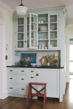 Details of this Edwardian-inspired kitchen include cabinets and light fixtures in the style of the period.