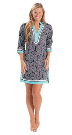 A pop of aqua is the perfect update to this classic black and white tunic dress!