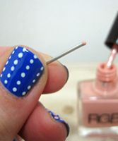 use a paper clip to make dots