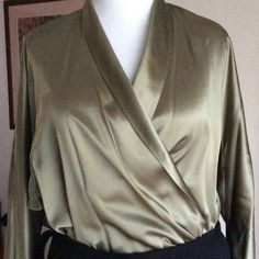 Vintage Mock-Wrap Silk Dress Blouse 100% Silk Mock-Wrap Blouse with long banded sleeves with fabric covered buttons. The top of the blouse overlaps, and the bottom is sewn on each side. The color is sort of an Olive Green. Excellent condition. Ellen Tracy Tops Blouses