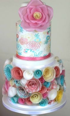 This cake was made using wafer paper to wrap a tier and to make the oversized flower and smaller flowers Pretty Cakes, Beautiful Cakes, Amazing Cakes, Wafer Paper Flowers, Wafer Paper Cake, Cake Flowers, Fondant Cakes, Cupcake Cakes, Smash Cakes