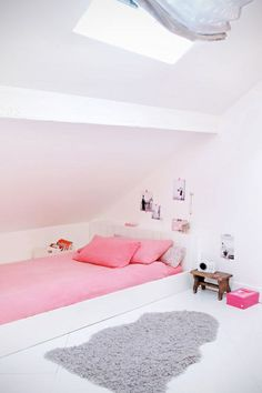 Girl's loft bedroom under the eaves with a built-in bed. I love this shade of pink with the white. Not overly girly yet definitely feminine. Boo and the Boy