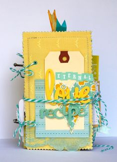 Check this out again.  Handmade mini scrapbook. Want to use the covers technique..