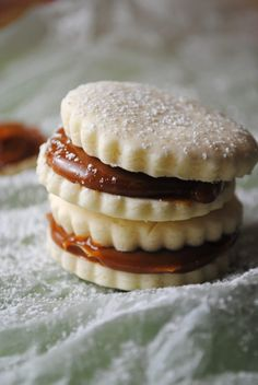 Alfajores (two cookies with the flavors of shortbread/snickerdoodles held together with dulce de leche) from The Cookiepedia via The Sweet Life Peruvian Desserts, Peruvian Recipes, Biscuit Cookies, Sandwich Cookies, Shortbread Cookies, Cookie Dough, Cookie Recipes, Dessert Recipes, Baking Recipes