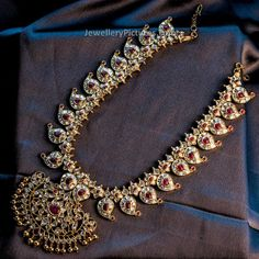 Precious south Indian Mango mala in classic design with kundans, rubies and gemstones. The paisley motifs mango haram is evergreen Gold Jewellery Design, Gold Jewelry, Designer Jewellery, Bridal Jewellery, Antique Jewelry, Diamond Jewellery, Engagement Jewellery, Diamond Necklaces, Gold Necklaces