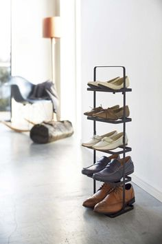 The Tower Steel Shoe Rack from Yamazaki is a clever way to store shoes. Made from powder coated steel, this slim, vertical tower holds five pairs of Shoe Rack Tall, Slim Shoe Rack, Narrow Shoe Rack, Small Shoe Rack, Narrow Shoes, Shoe Rack Store, Steel Shoes, Rack Design, Shoe Storage