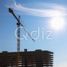 Qdiz Stock Photos | Building crane on construction,  #architecture #blue #build #building #built #business #City #construct #construction #crane #development #engineering #equipment #estate #growth #house #industrial #industry #modern #site #sky #steel #Sun #technology #urban #work