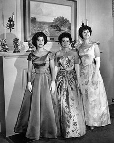 First Lady Bird Johnson with her daughters Luci Baines and Lynda Bird pose in New York City on Jan. 12, 1961. They are modeling the gowns they will wear at the Presidential Inaugural Ball on Jan. 20, 1961.
