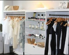 Boutique Decor - clothes on the sides and chotchkes in the center