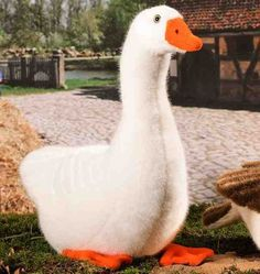 This lovely realistic 37cm white goose is handmade in Germany by the soft toy maker Kosen. He is made of high quality soft white plush with hand stitched feather effect and is filled with granules to give him a lovely weight. This Kosen product conforms to European Safety Standard EN71 and carries the CE mark.  He can be hand washed.